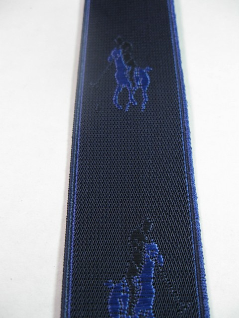 "HORSE WITH RIDER WITH ROYAL BLUE AND BLACK ON NAVY BLUE BACKGROUND. ""Y"" STYLE 1 1/3"" X 48"" DELUXE SUSPENDERS.WITH GOLD GRIPS AND 2 LENGTH ADUSTERS    YD-POL76B48#107g"
